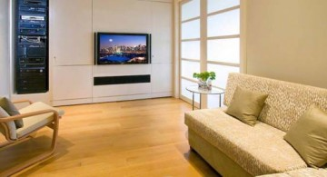 modern built-in TV design in a cozy minimalist living room with beige color scheme