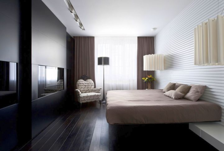 modern floating bed with wall panel as headboard