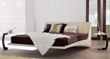 modern floating bed with white frame and chocolate bedding
