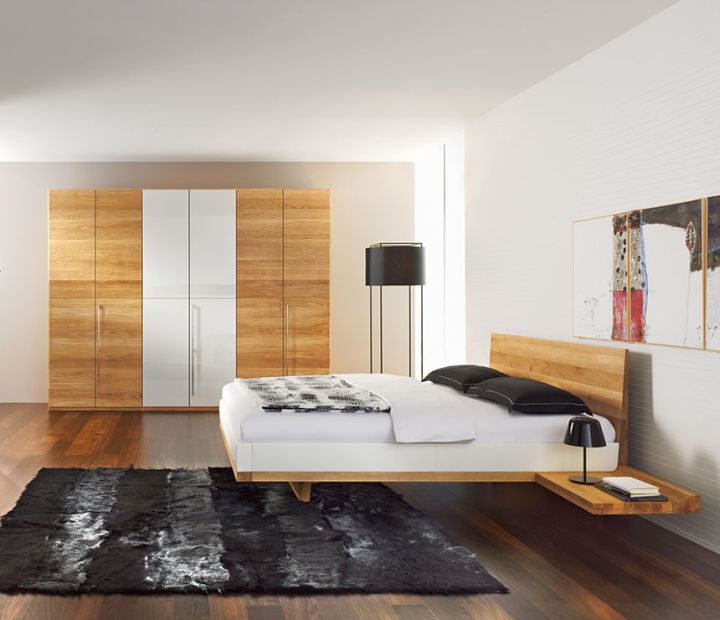 modern floating bed with wooden floor and black rug