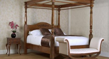 modern four poster bed with a settee