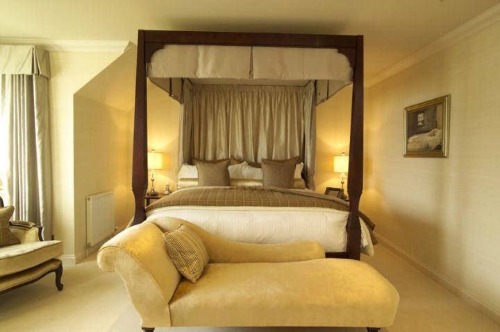 modern four poster bed with half canopied headboard