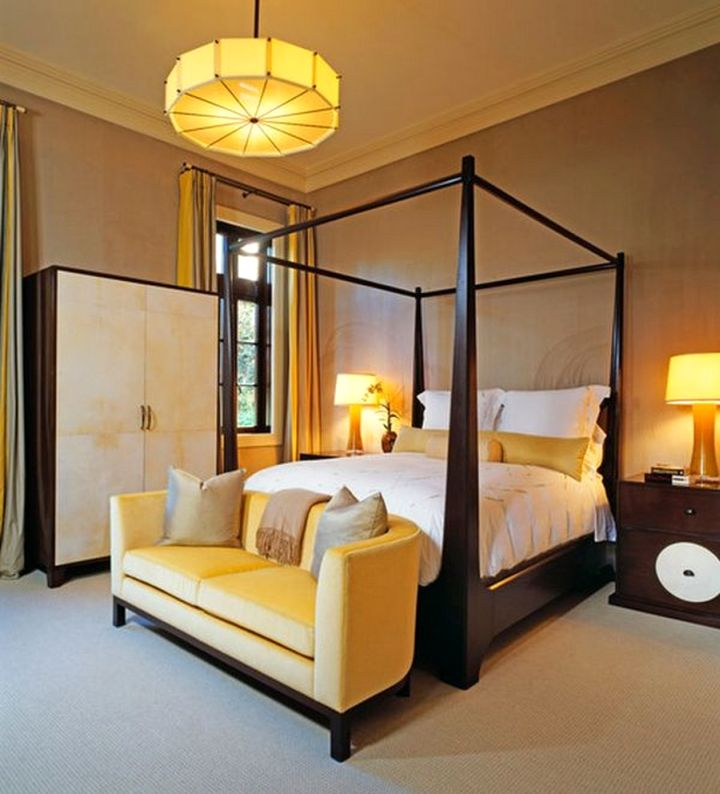 modern four poster bed with pendant light