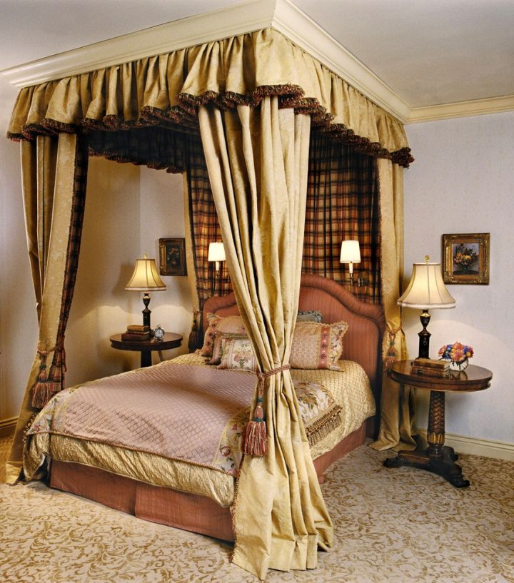 modern four poster bed with plush canopy