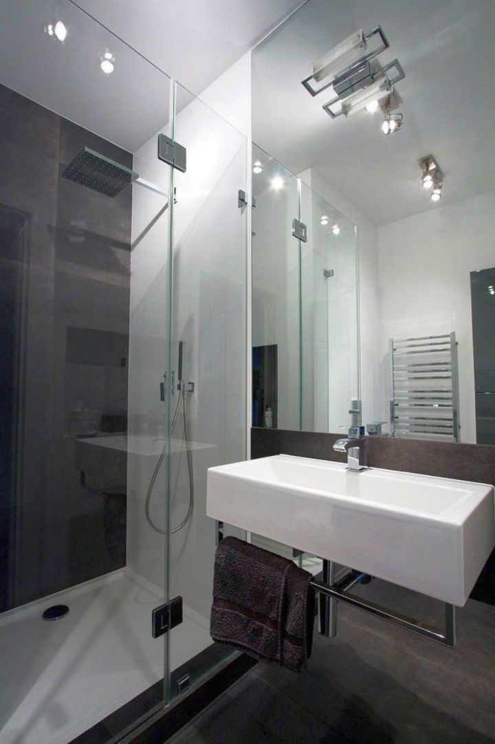 modern glass shower with track lighting