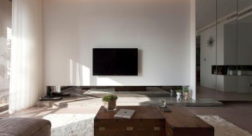 modern minimalist living room with mirror wall panel