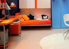 modern orange murphy bed unit with desk and contemporary white chair