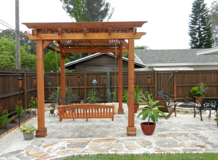 modern pergola kit with a swing
