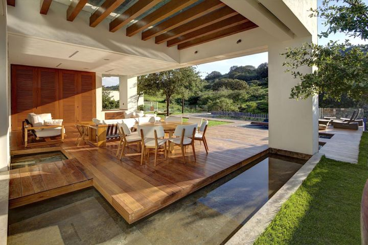 modern water features next to dining room