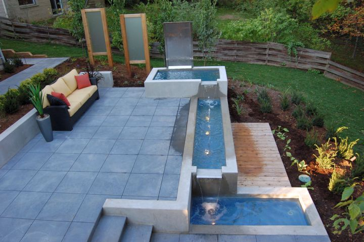 modern water features tiered on stone deck