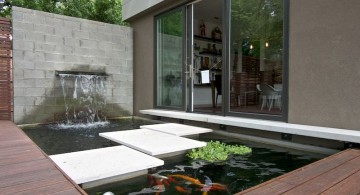 modern water features with stone pathway on a pond