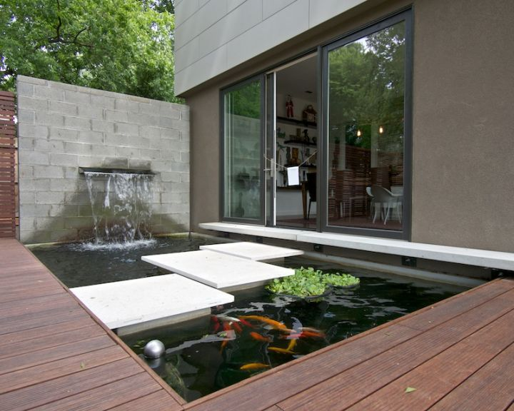 17 modern water feature designs for your garden for Contemporary koi pond design
