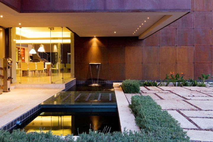 modern water features with stone pathway