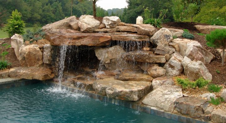 17 fascinating pools with waterfalls ideas for Swimming pool fountains waterfalls