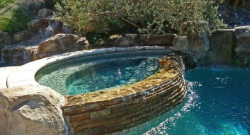 pool waterfall ideas with rustic stone wall