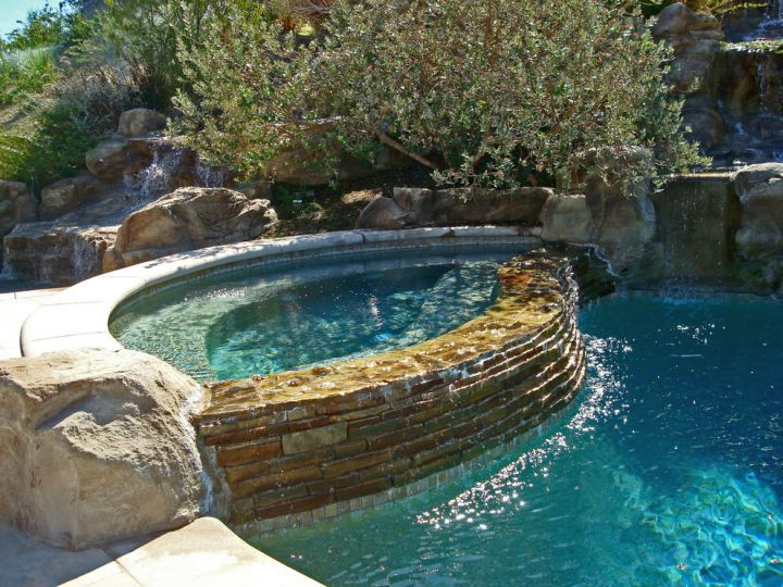 Pool waterfall ideas with rustic stone wall for Rustic pools