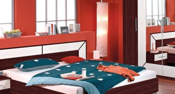 red bedroom walls with wooden floor