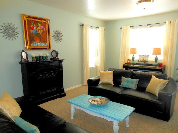 room arrangements with black vinyl sofa