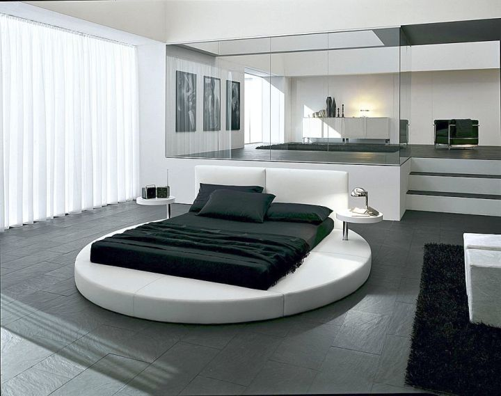 round bed frame with normal mattress in monochrome