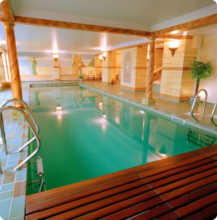 simple enclosed swimming pool with wooden deck
