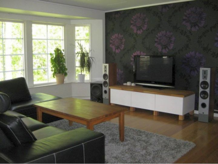 simple living room with black wall panel