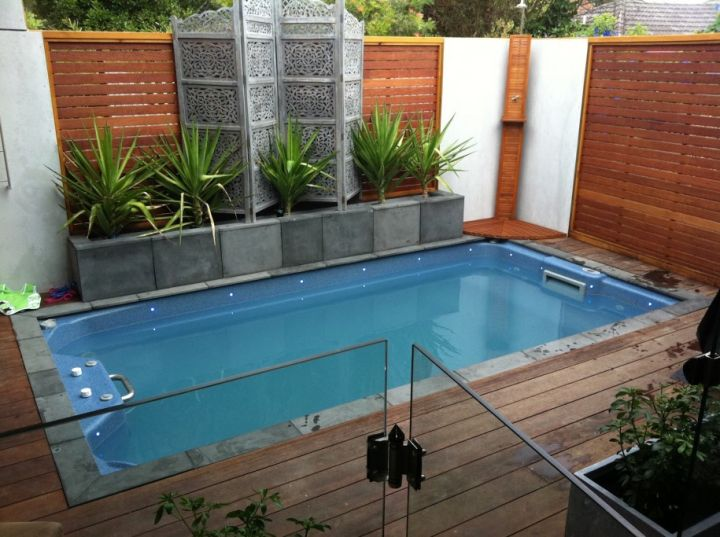 Small Pool Design Ideas 28 fabulous small backyard designs with swimming pool Simple Small Pool Ideas With Tall Wooden Walls