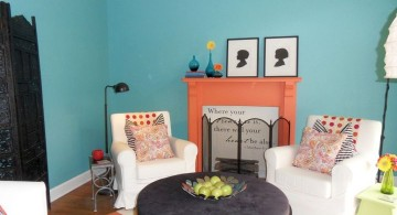 simple turquoise living room decor with fireplace