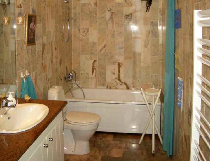 Small brown bathrooms with turquoise curtain for Brown and turquoise bathroom ideas