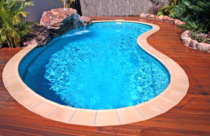small kidney shape pool with wooden deck