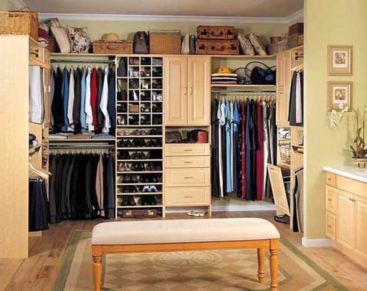 small walk in closet furniture with settee