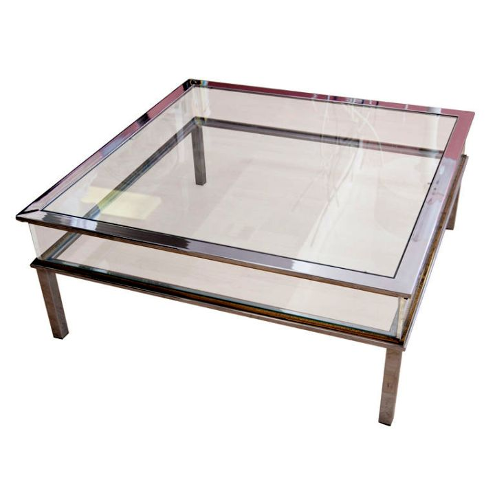 square lucite coffee table lined with glass