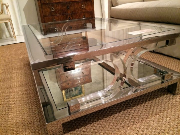 square lucite coffee table with X stand and lined with steel
