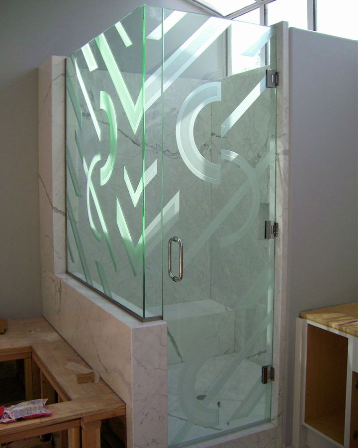 textured modern glass shower on marble walls