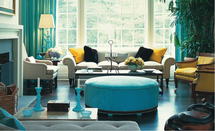 turquoise living room decor ottoman sofa, curtains, and small candelabra