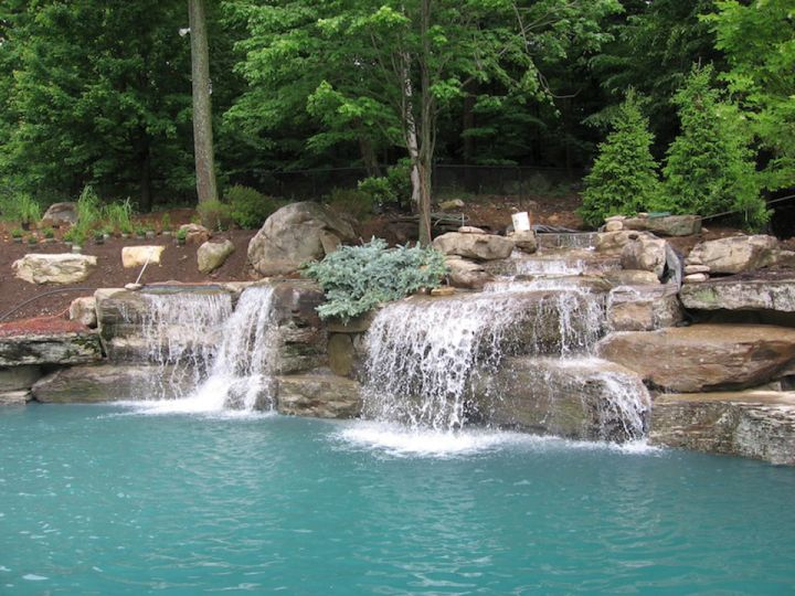 17 simply gorgeous pool waterfall ideas for Pool design waterfall