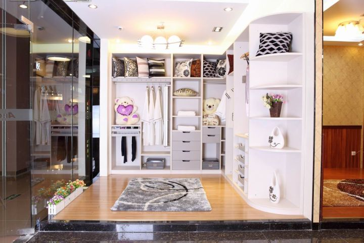 walk in closet furniture with glass wall