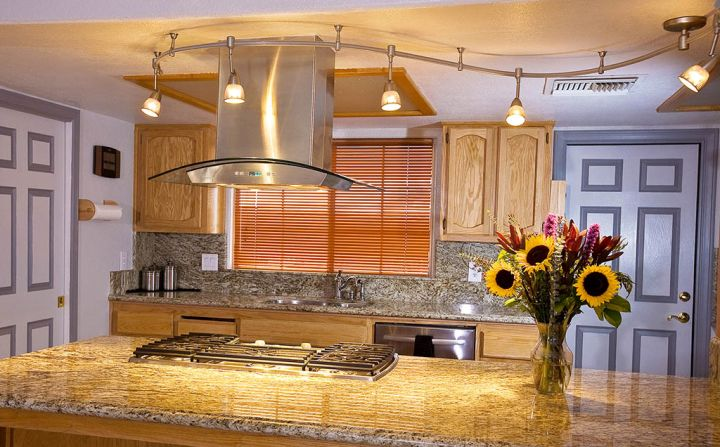 waved track lighting ideas above kitchen island