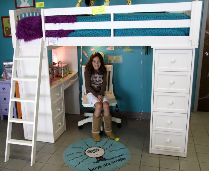 white loft bed with desk and many drawers