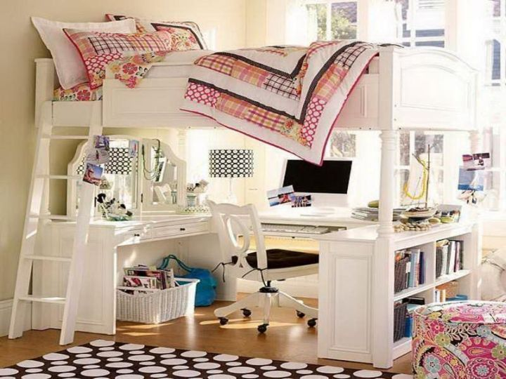 white loft bed with desk with pink bedding