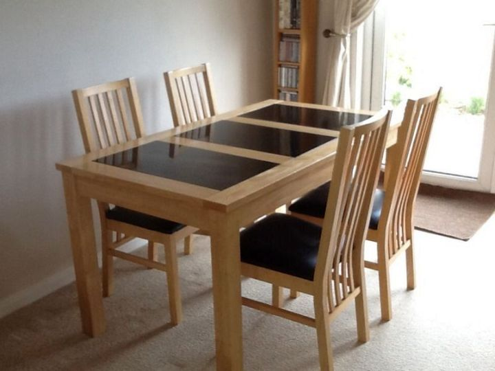 http://www.myaustinelite.com/wp-content/uploads/2015/02/wood-and-granite-dining-room-table.jpg