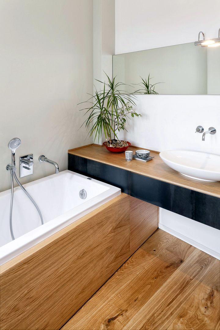 wood bathroom with in ground tub