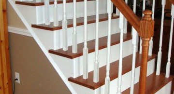 wood staircase with white balusters