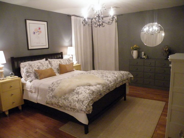 yellow gray bedroom with chandelier