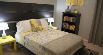 yellow gray bedroom with large headboard