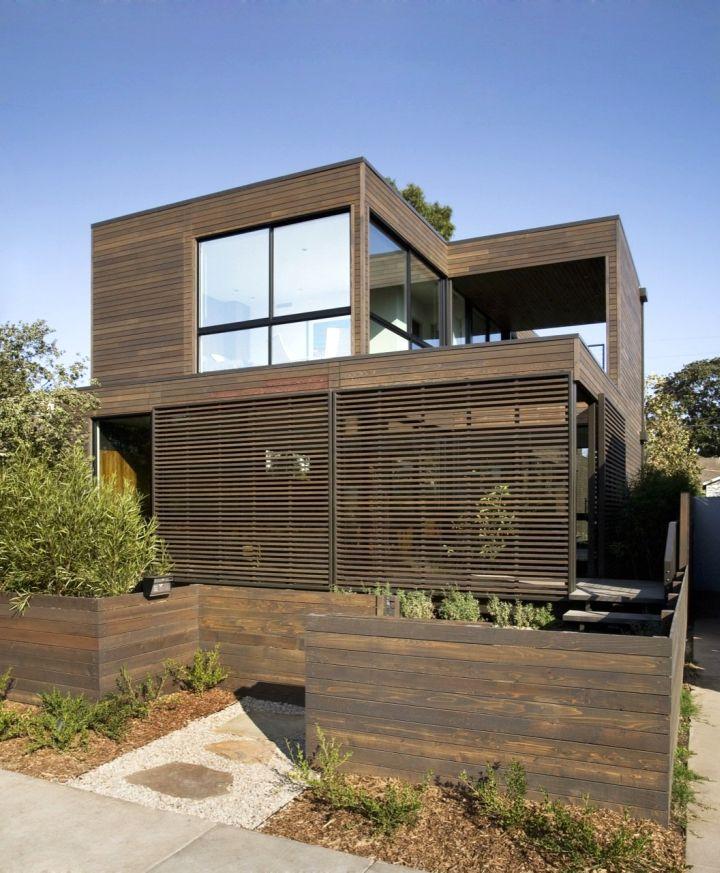 contemporary mobile homes with natural woods and small garden