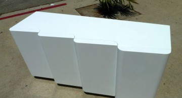 contemporary waved white lacquer credenza