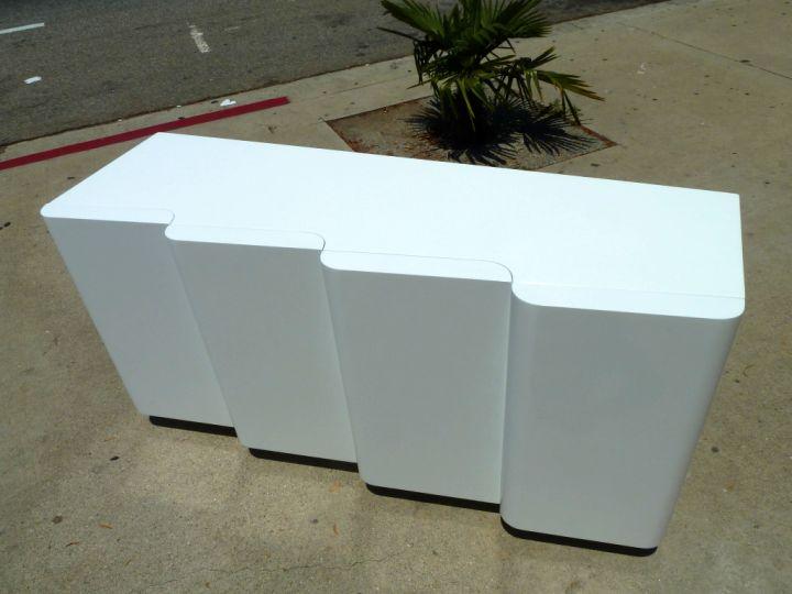 contemporary waved white lacquer credenza