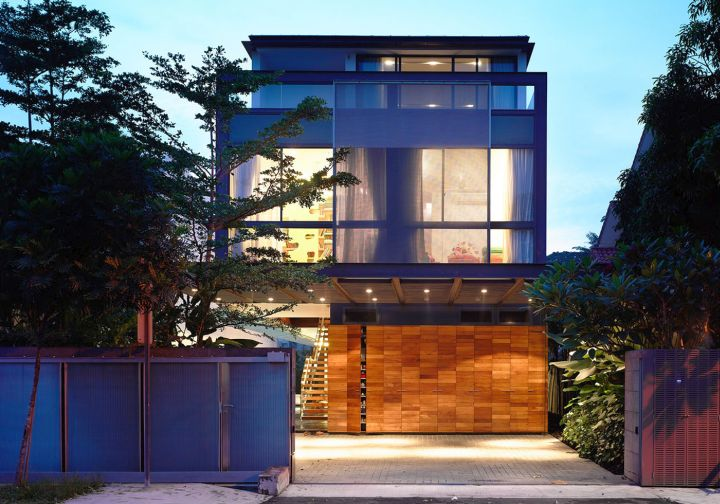 detached modern house front facade at night