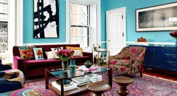 eclectic rooms with blue wall and flower sofa