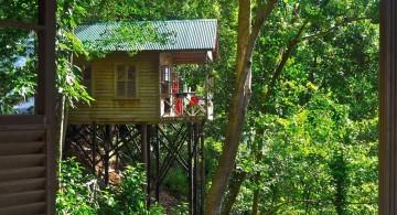 half hidden treehouse on stilts